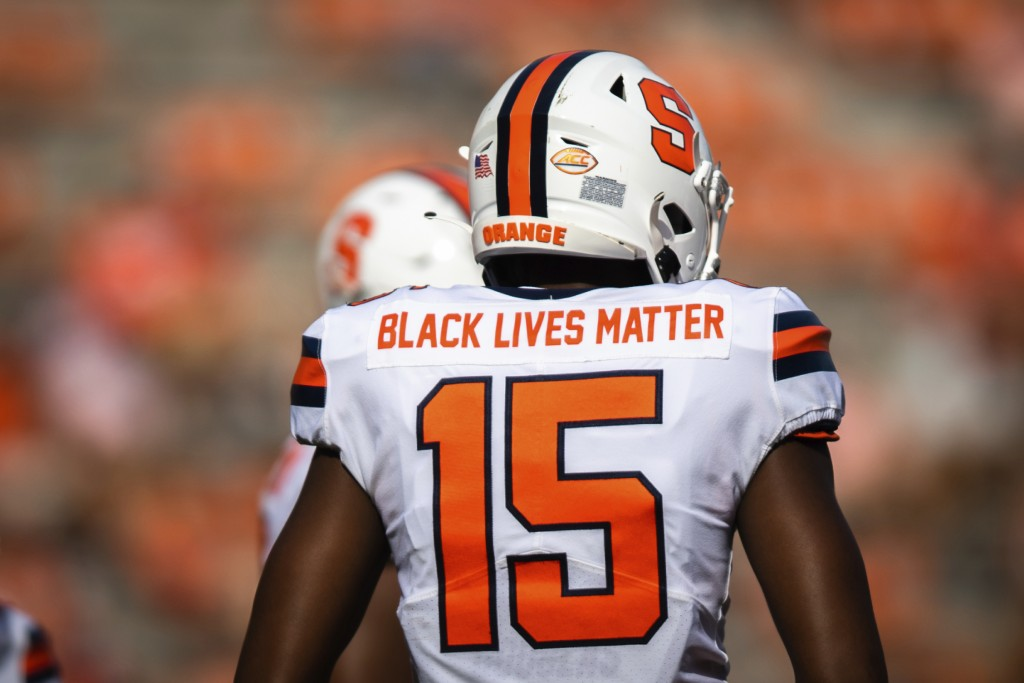 Syracuse quarterback JaCobian Morgan (15) wears a jersey with Black Lives Matter printed on the back during an NCAA college football game against Clem...