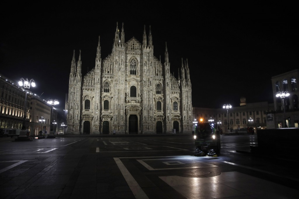 A street cleaning vehicle washes the square in front of the Duomo gothic cathedral, in Milan, northern Italy, early Sunday, Oct. 25, 2020. Since the 1...