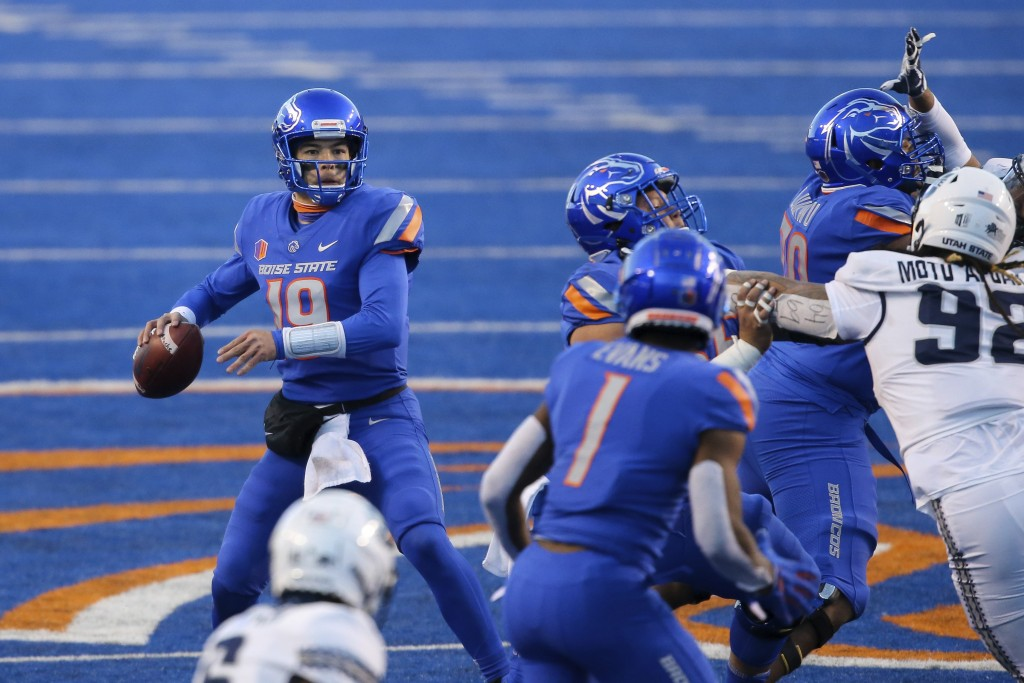 Boise State quarterback Hank Bachmeier (19) looks down field to throw the ball against Utah State during the first half of an NCAA college football ga...
