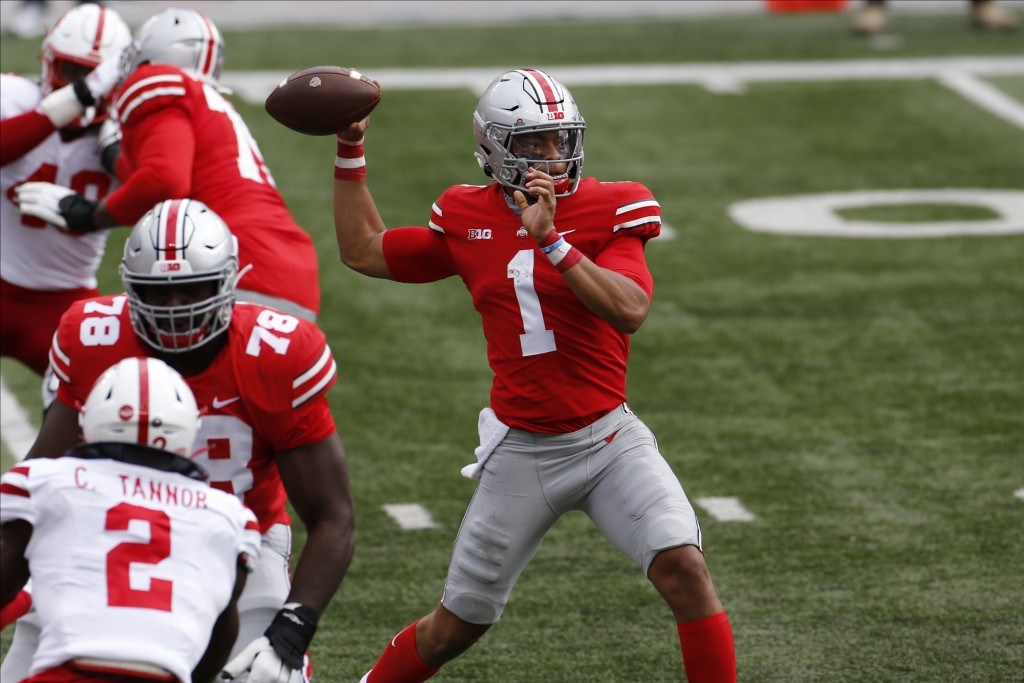 Ohio State quarterback Justin Fields throws a pass against Nebraska during the first half of an NCAA college football game Saturday, Oct. 24, 2020, in...