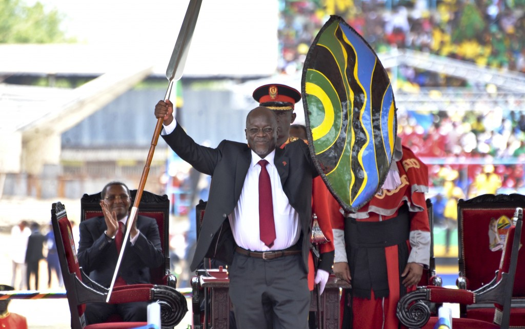 FILE - In this Thursday, Nov. 5, 2015 file photo, Tanzania's President John Magufuli holds up a ceremonial spear and shield to signify the beginning o...