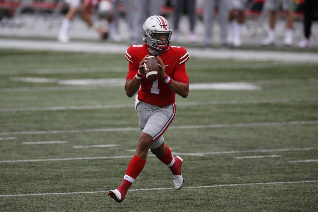 Ohio State quarterback Justin Fields drops back to pass against Nebraska during the second half of an NCAA college football game Saturday, Oct. 24, 20...
