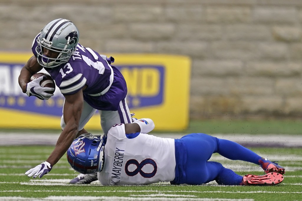 Kansas State wide receiver Chabastin Taylor (13) is tackled by Kansas cornerback Kyle Mayberry (8) during the second half of an NCAA college football ...
