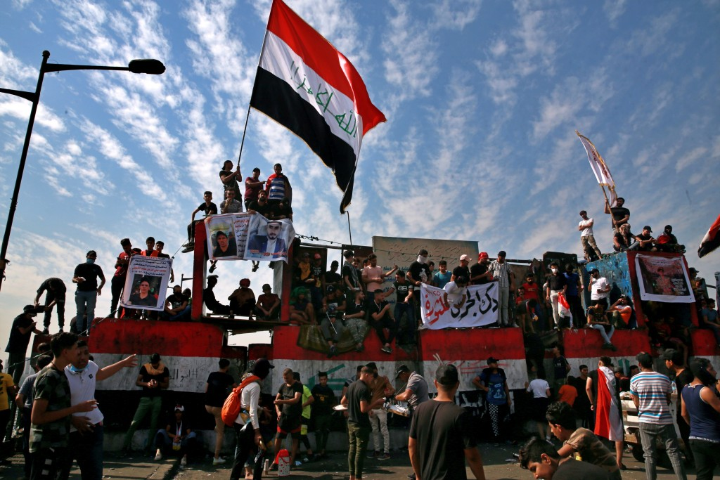 Thousands rally in Iraq to mark one year of protests ...