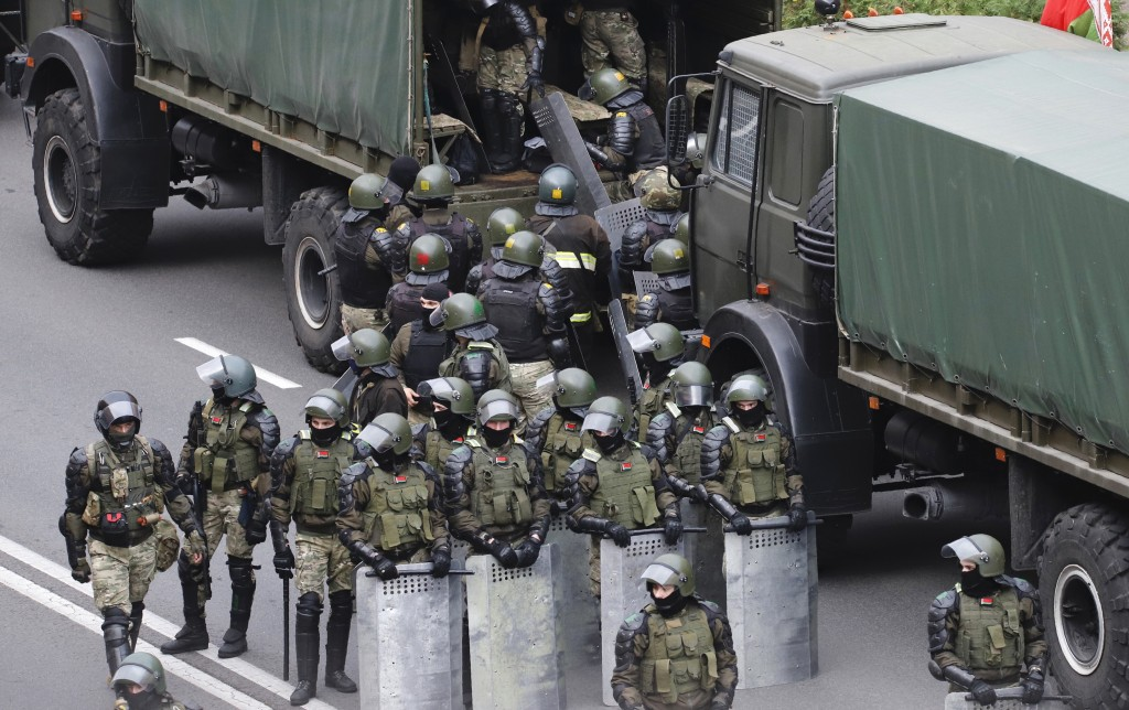 Belarusian police block a street during an opposition rally to protest the official presidential election results in Minsk, Belarus, Sunday, Oct. 25, ...