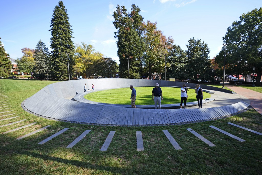 Visitors look over inscriptions on the walls of the Memorial to Enslaved Laborers at the University of Virginia in Charlottesville, Va., Friday Oct. 2...