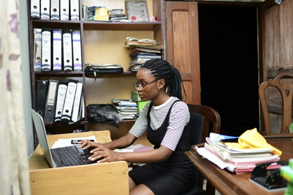 In this photo taken on Tuesday, Oct. 13, 2020, Dodeye Ewa, 16 year old study at the family library in Calabar, Nigeria. The third child is bothered by...