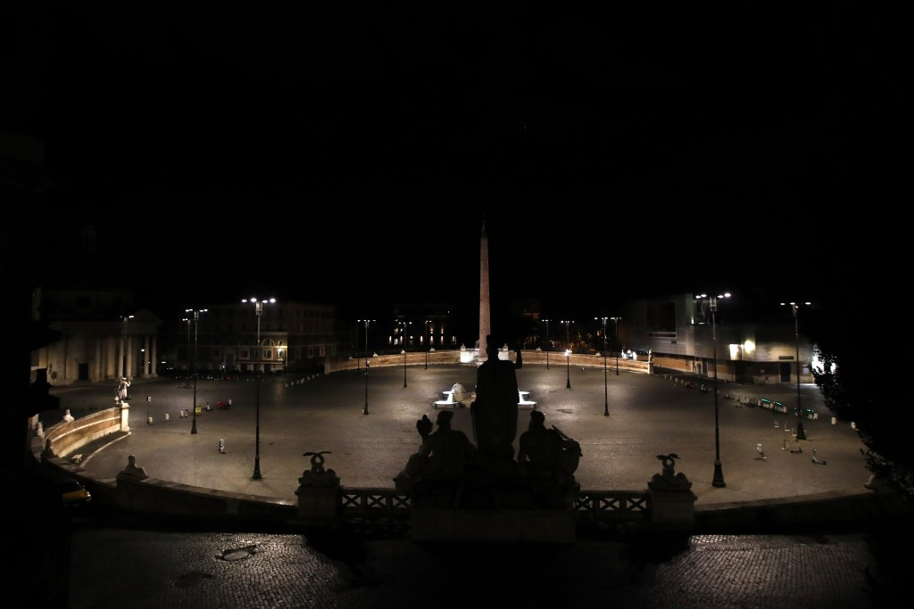 An empty Piazza del Popolo Square is seen in Rome, early Monday, Oct. 26, 2020. Since an 11 p.m.-5 a.m. curfew took effect Friday, people can only mov...