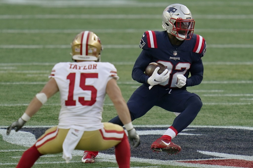 New England Patriots defensive back Devin McCourty, right, runs from San Francisco 49ers wide receiver Trent Taylor (15) after intercepting a pass in ...