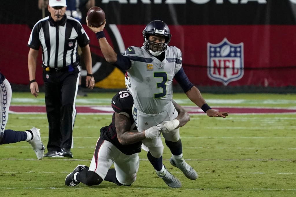 Seattle Seahawks quarterback Russell Wilson (3) gets the throw off as Arizona Cardinals linebacker Kylie Fitts makes the hit during the second half of...