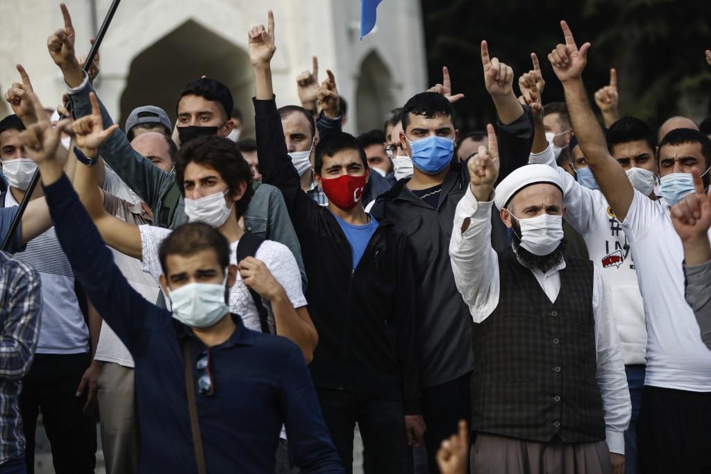 Demonstrators chant slogans during an anti-France protest in Istanbul, Sunday, Oct. 25, 2020. Turkish President Recep Tayyip Erdogan on Sunday challen...