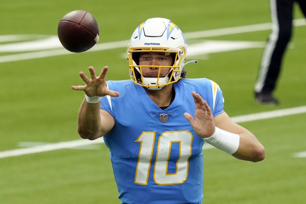 Los Angeles Chargers quarterback Justin Herbert pitches the ball during the first half of an NFL football game against the Jacksonville Jaguars Sunday...
