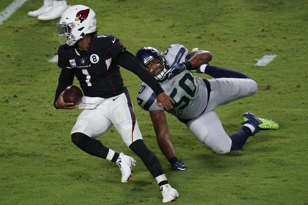 Arizona Cardinals quarterback Kyler Murray (1) breaks the tackle of Seattle Seahawks outside linebacker K.J. Wright (50) for a touchdown during the se...