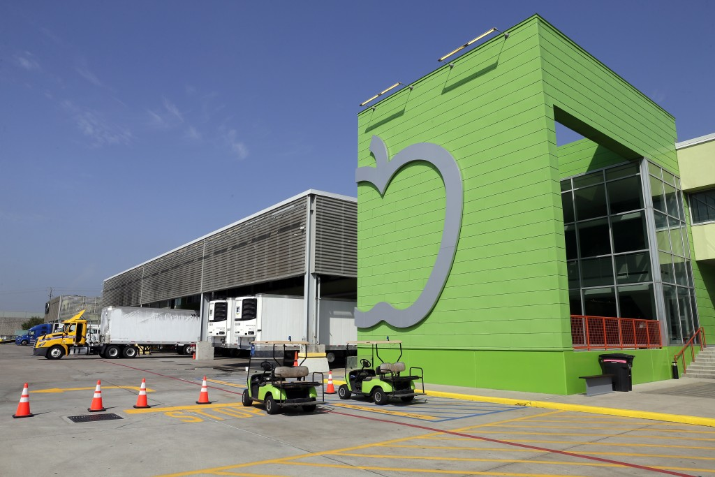 The main client entrance and loading docks of the Houston Food Bank are seen Wednesday, Oct. 14, 2020, in Houston. Distributions by the Houston Food B...