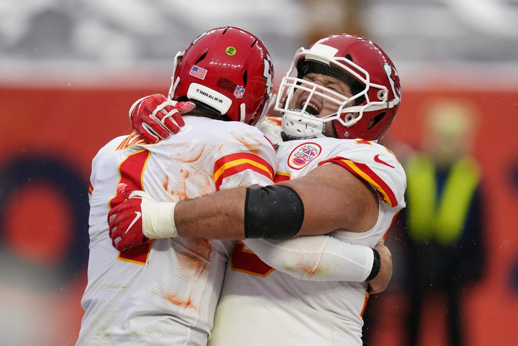 Kansas City Chiefs quarterback Chad Henne, left, celebrates with offensive guard Nick Allegretti after scoring a touchdown during the second half of a...