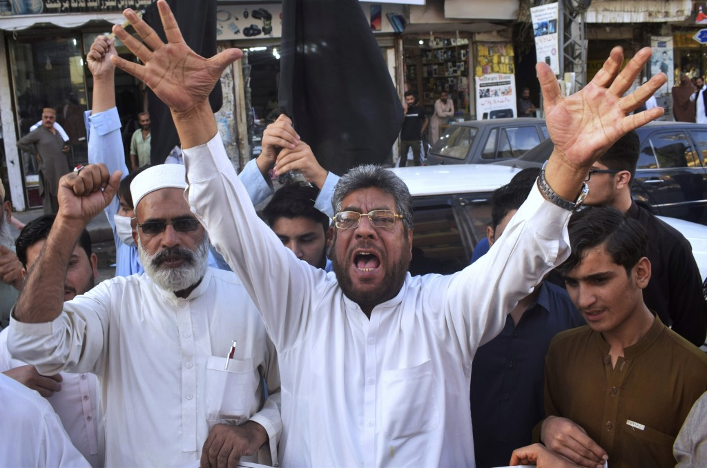 Pakistan traders chant anti-French slogans against the publishing of caricatures of the Prophet Muhammad they deem blasphemous, in Peshawar, Pakistan,...