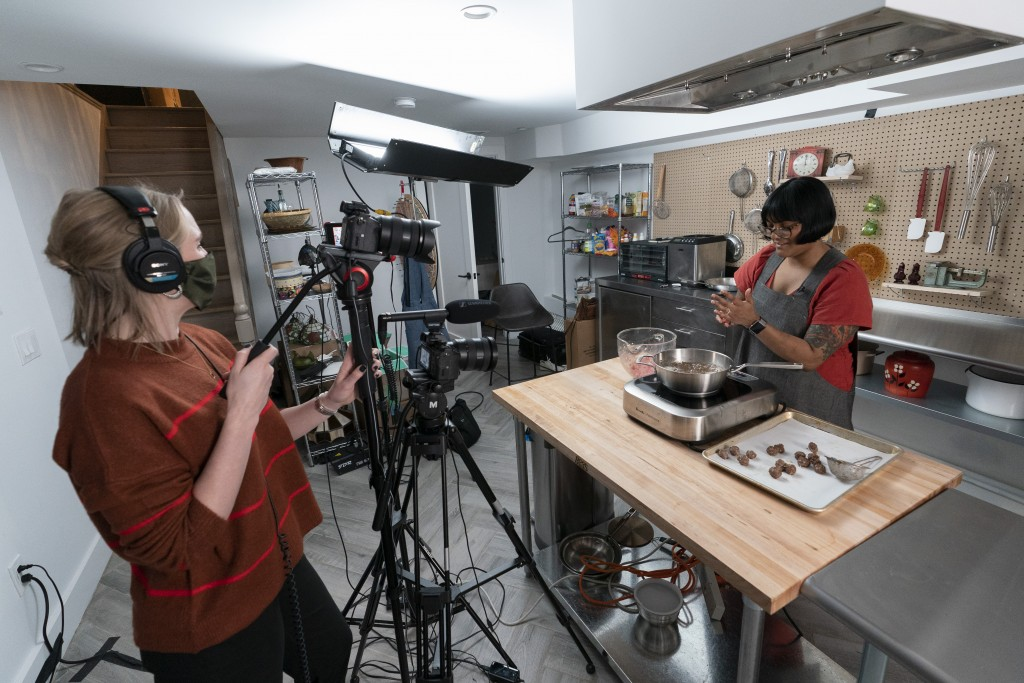"In this Oct. 7, 2020 photo, Producer Jessica Opon, left, films as chef Sohla El-Waylly prepares Swedish meatballs during a taping of ""Stump Sohla,"" in..."