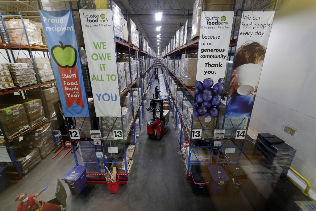 Pallets of various foods are stacked on shelves in the extensive warehouse at the Houston Food Bank Wednesday, Oct. 14, 2020, in Houston. It's the lar...