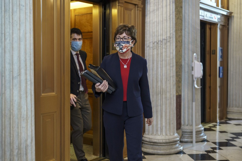 Sen. Susan Collins, R-Maine, arrives for votes during a rare weekend session to advance the confirmation of Judge Amy Coney Barrett to the Supreme Cou...
