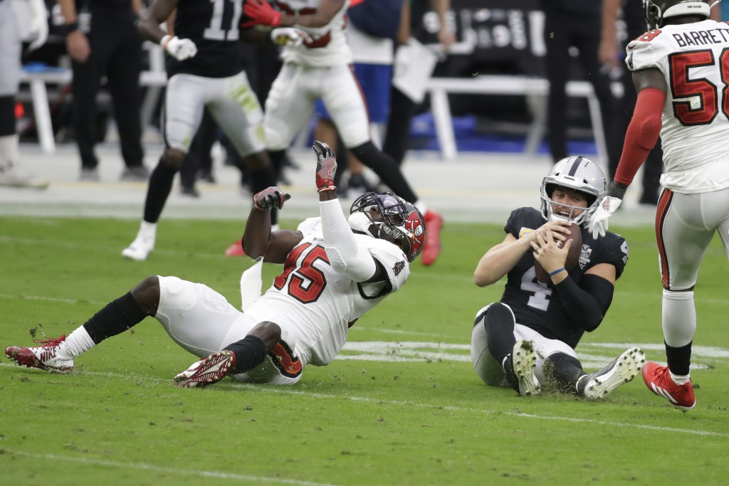 Tampa Bay Buccaneers inside linebacker Devin White (45) sacks Las Vegas Raiders quarterback Derek Carr (4) during the first half of an NFL football ga...
