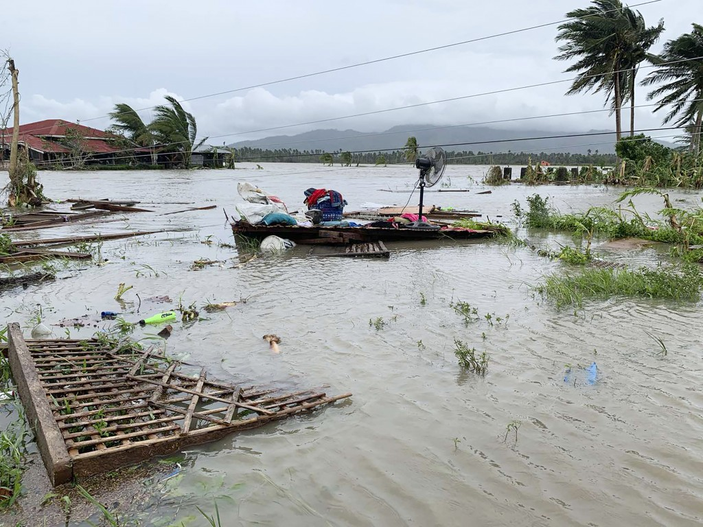 The remains of a house is surrounded by floods in Pola town on the island of Mindoro, central Philippines, Monday, Oct. 26, 2020. A fast-moving typhoo...