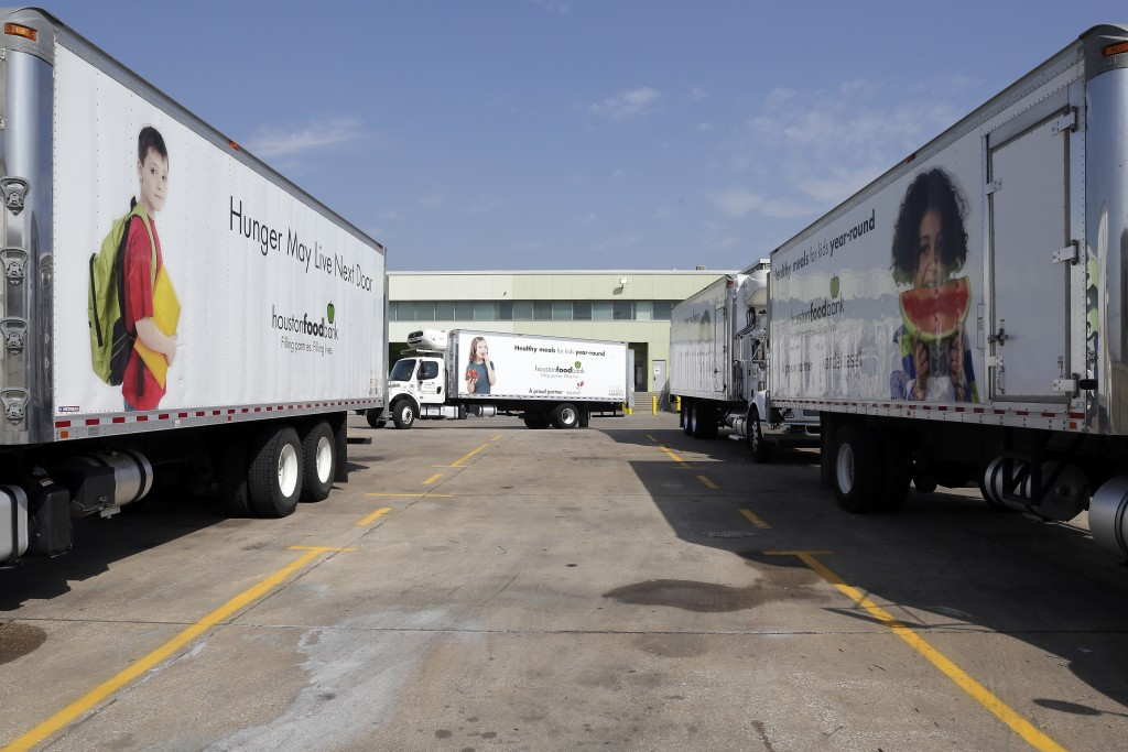 Container trucks are seen in the parking lot of the Houston Food Bank Wednesday, Oct. 14, 2020, in Houston. Distributions by the Houston Food Bank now...