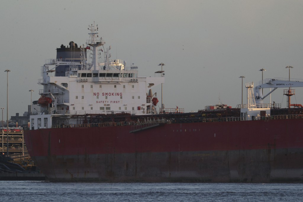The Nave Andromeda oil tanker is docked next to the Queen Elizabeth II Cruise Terminal in Southampton, England, Monday, Oct. 26, 2020. The U.K. milita...