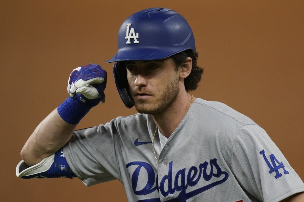 Los Angeles Dodgers' Cody Bellinger celebrates his RBI-single against the Tampa Bay Rays during the first inning in Game 5 of the baseball World Serie...