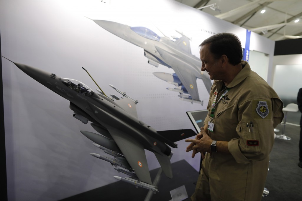 FILE - In this Feb. 5, 2020, file photo, Lockheed Martin's Robert Balserak, Lead Executive, Air Superiority Programs, explains the capabilities of the...