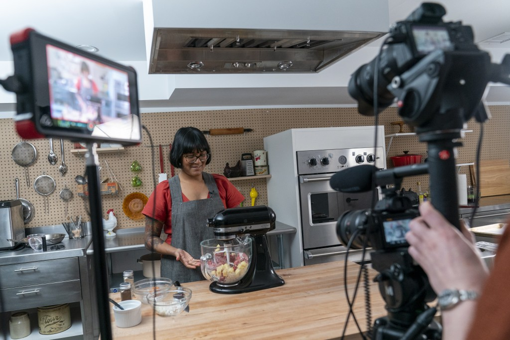 "In this Oct. 7, 2020 photo, chef Sohla El-Waylly prepares Swedish meatballs during a taping of ""Stump Sohla,"" in New York. El-Waylly became a familiar..."