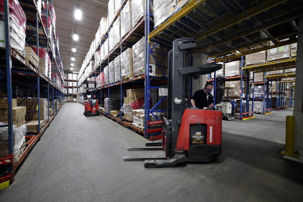 Pallets of various foods, both perishable and non-perishable, are constantly repositioned by fork lifts within the warehouse to expedite routing and d...