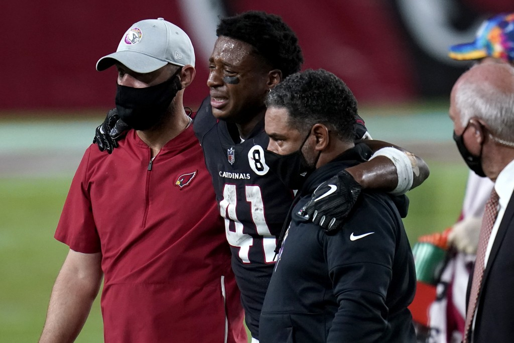 Arizona Cardinals running back Kenyan Drake (41) is helped off the field after an injury during the second half of an NFL football game against the Se...