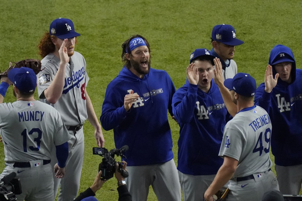Los Angeles Dodgers starting pitcher Clayton Kershaw, center, celebrates after their win against the Tampa Bay Rays in Game 5 of the baseball World Se...