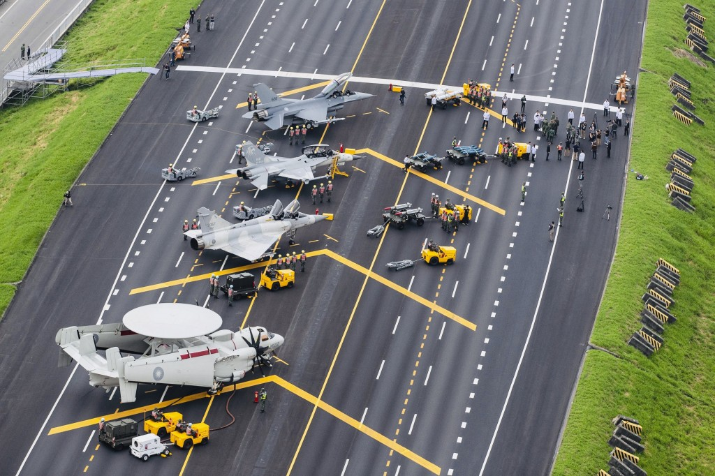 FILE - In this file photo released by Taiwan's Military News Agency, Taiwan war planes are parked on a highway during an exercise to simulate a respon...