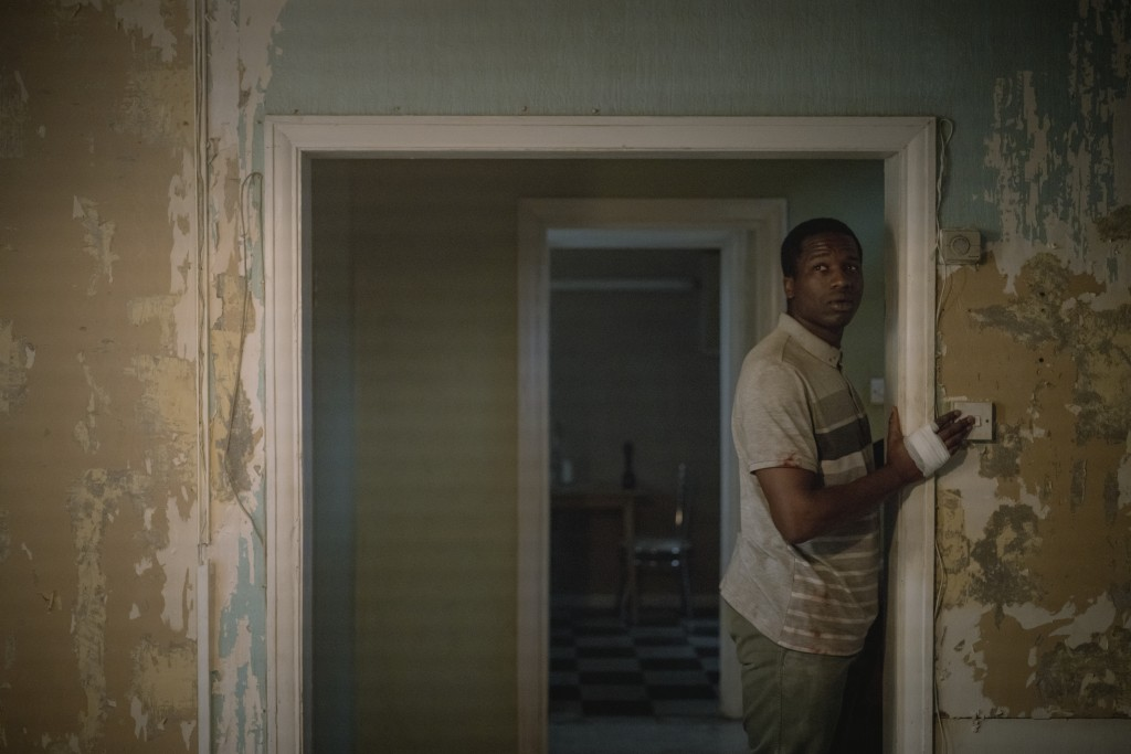"This image released by Netflix shows Ṣọpẹ Dìrísù as Bol Majur in a scene from ""His House."" (Aidan Monaghan/Netflix via AP)"