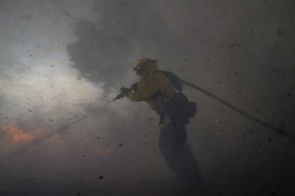 A firefighter battles the Silverado Fire Monday, Oct. 26, 2020, in Irvine, Calif. A fast-moving wildfire forced evacuation orders for 60,000 people in...