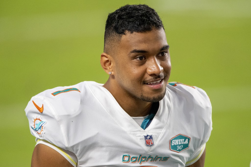 FILE  - This Oct. 18, 2020, file photo shows Miami Dolphins quarterback Tua Tagovailoa (1)  on the sidelines before playing for the first time against...