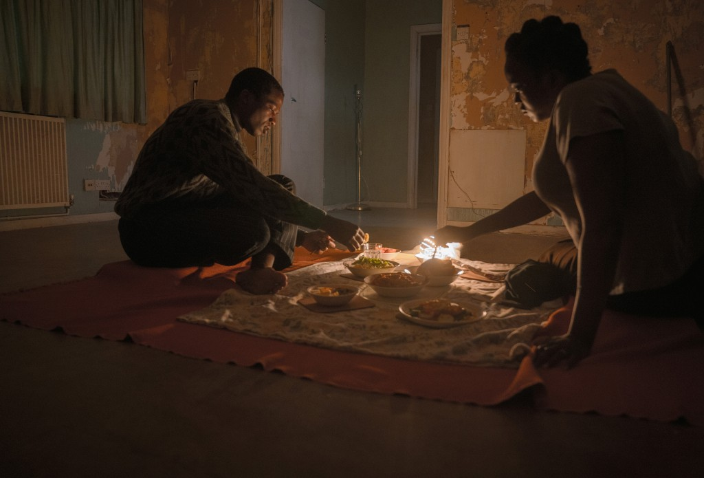 """This image released by Netflix shows Wunmi Mosaku as Rial Majur, right, and Ṣọpẹ Dìrísù as Bol Majur in a scene from """"His House."""" (Aidan Monaghan/Netf..."""