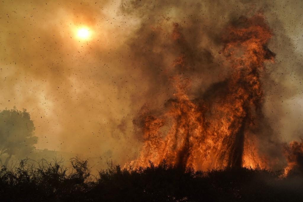 The Silverado Fire burns along the 241 State Highway Monday, Oct. 26, 2020, in Irvine, Calif. A fast-moving wildfire forced evacuation orders for 60,0...