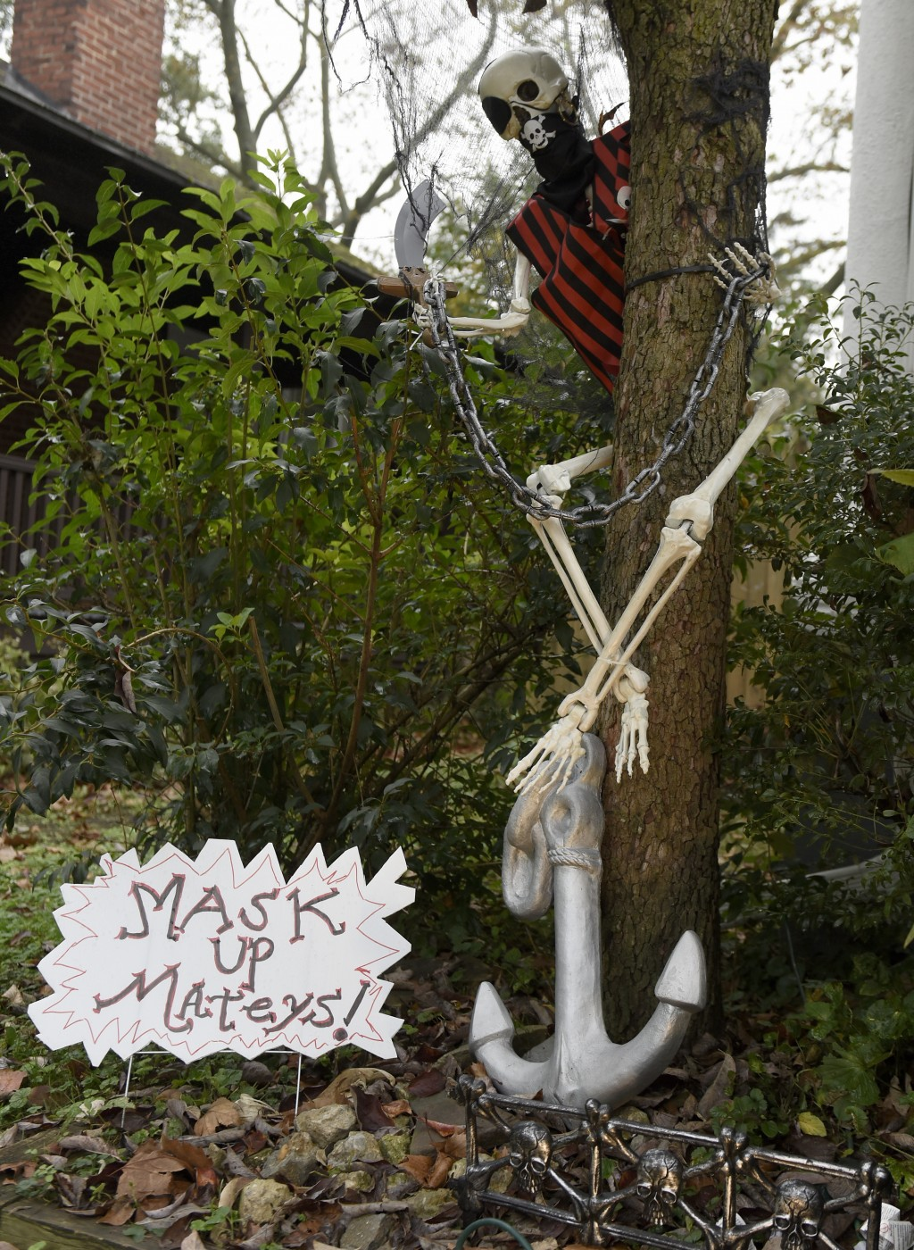 Pirate-themed Halloween decorations are seen at the home of Carol McCarthy, reminding people to be safe while trick-or-treating during the COVID-19 pa...
