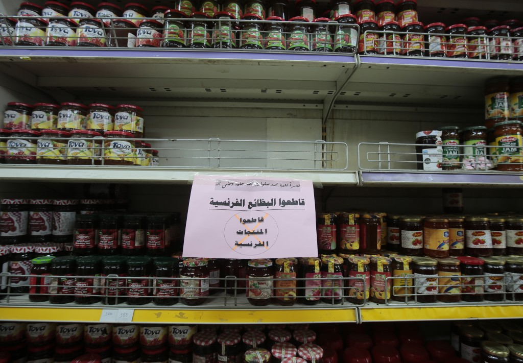 A notice calling for a boycott French products is displayed at a supermarket in Sanaa, Yemen, Monday, Oct. 26, 2020. Muslims in the Middle East and be...