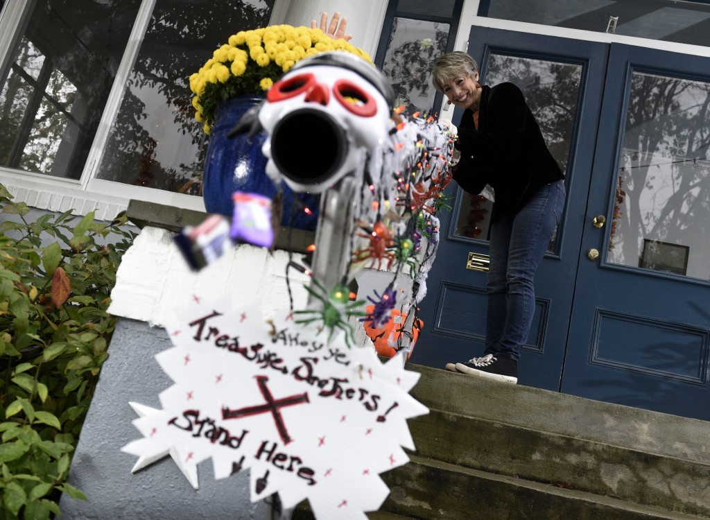 Carol McCarthy sends candy down the candy chute that she will use to give out treats to socially-distant trick-or-treaters on Halloween, Monday, Oct. ...