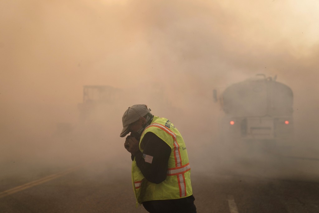 Len Brongo struggles with smoke from the Silverado Fire Monday, Oct. 26, 2020, in Irvine, Calif. A fast-moving wildfire forced evacuation orders for 6...