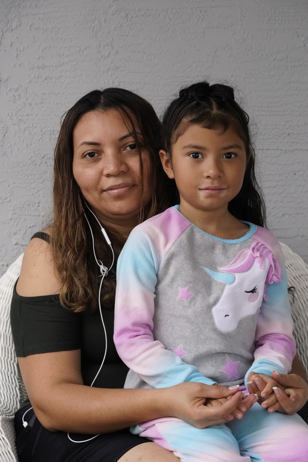 Temporary Protected Status (TPS) holder Lili Montalvan, left, of El Salvador, poses for a photo with her daughter Roxana Gozzer, 6, Sunday, Oct. 25, 2...