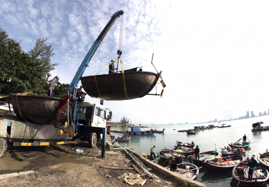 People move fishing boats to save place ahead of Typhoon Molave in Danang, Vietnam on Monday, Oct. 26, 2020. National agency forecasts the typhoon to ...