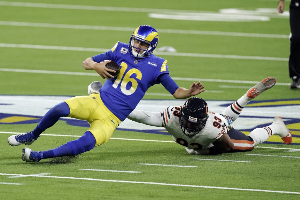 Los Angeles Rams quarterback Jared Goff (16) slides in front of Chicago Bears linebacker James Vaughters (93) during the second half of an NFL footbal...