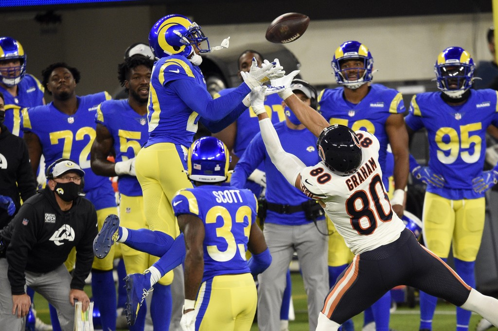 Los Angeles Rams cornerback Jalen Ramsey, left, intercepts a pass intended for Chicago Bears tight end Jimmy Graham (80) during the second half of an ...