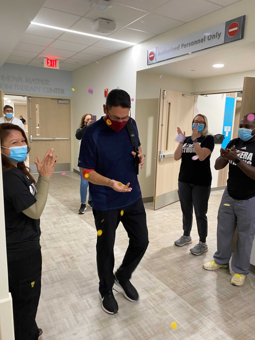 In this photo provided by Inova Health System, Washington Football Team NFL football head coach Ron Rivera leaves the Inova Schar Cancer Institute in ...
