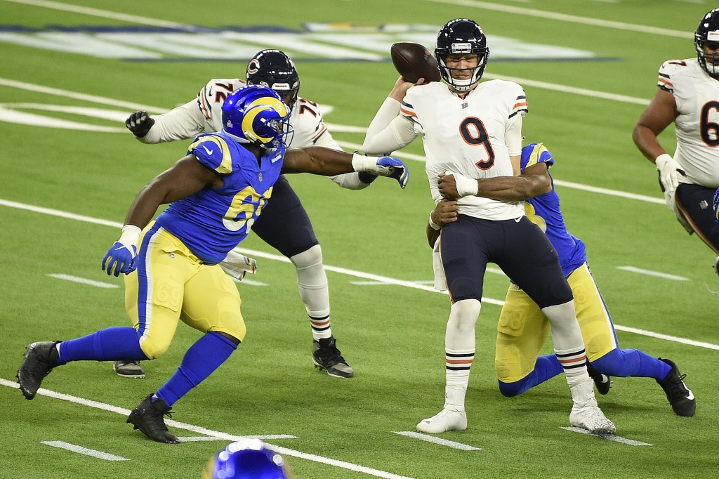 Chicago Bears quarterback Nick Foles (9) is sacked by Los Angeles Rams linebacker Justin Hollins during the second half of an NFL football game Monday...