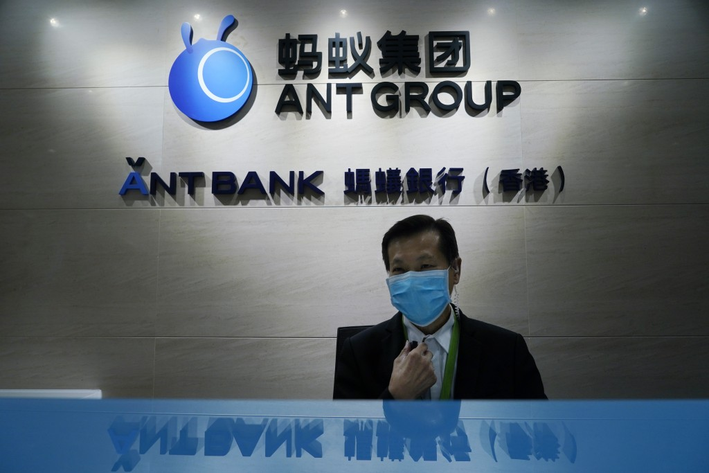In this Friday, Oct. 23, 2020, photo, an employee sits at the Ant Group office in Hong Kong. The world's largest fintech company, China's Ant Group, w...